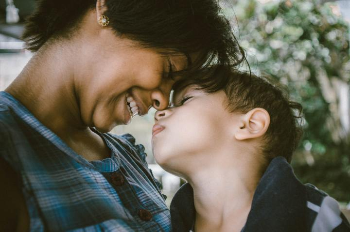 Mother and son touch noses