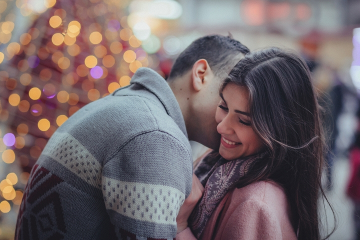 Man Kissing Woman Smiling